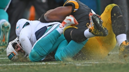 Miami Dolphins quarterback Matt Moore, left, gets hit by Pittsburgh Steelers outside linebacker James Harrison in the first half of an AFC wild-card NFL football game in Pittsburgh on Sunday, Jan. 8. 2017. (Jim Rassol/South Florida Sun-Sentinel via AP)