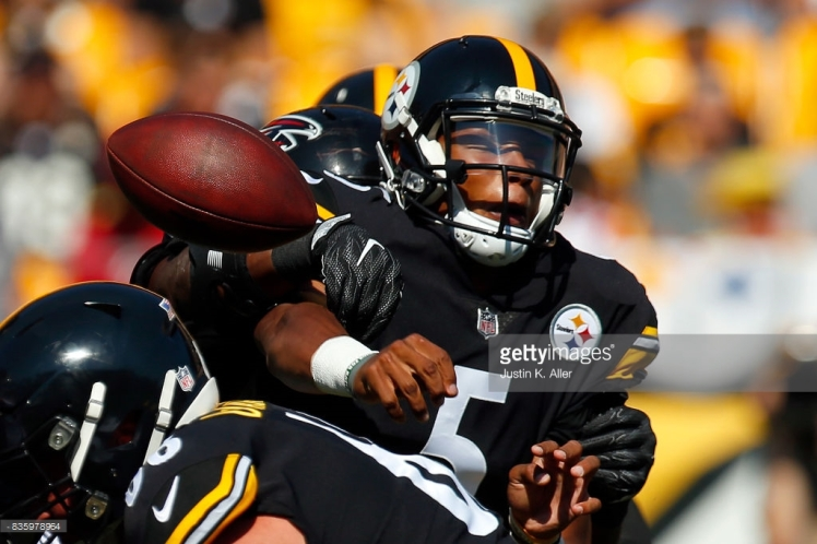 Dobbs tackled