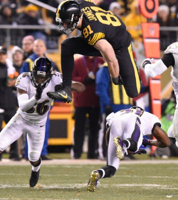 FILE - In this Sunday, Dec. 25, 2016, file photo, Pittsburgh Steelers tight end Jesse James (81) leaps over Baltimore Ravens cornerback Chris Lewis-Harris (31) before being tackled by cornerback Tavon Young (36) during the second half of an NFL football game in Pittsburgh. Sure, the play that clinched the AFC North title for the Pittsburgh Steelers went to Antonio Brown. The majority of the game-winning drive on Sunday night agains Baltimore went to role players like Jesse James or rookies and practice squad grads like Eli Rogers and Cobi Hamilton. (AP Photo/Don Wright, File)