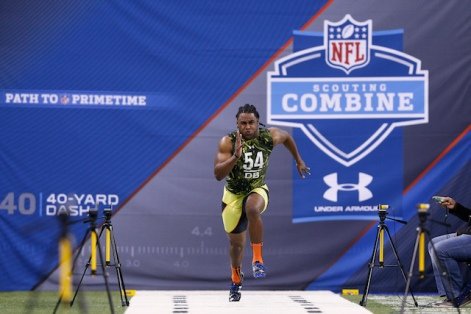 INDIANAPOLIS, IN - FEBRUARY 26: J.J. Wilcox of Georgia Southern runs the 40-yard dash during the 2013 NFL Combine at Lucas Oil Stadium on February 26, 2013 in Indianapolis, Indiana. (Photo by Joe Robbins/Getty Images)